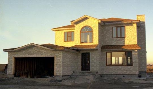 Revestimiento de casas prefabricadas monocapa en casas for Casas americanas de madera