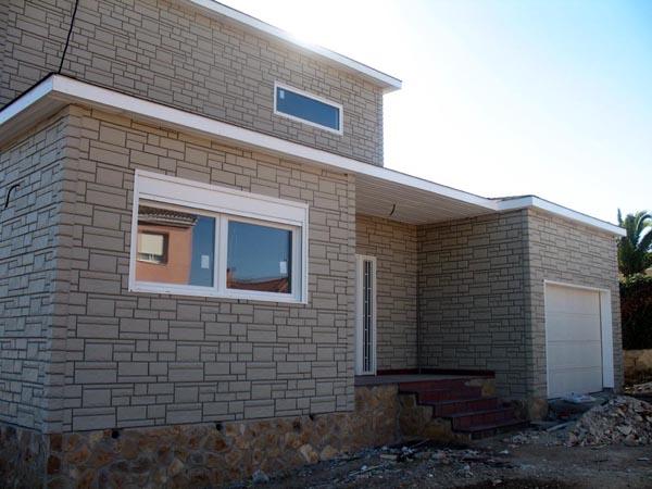Casa de madera casas prefabricadas foto casa de madera acabado exterior con imitacion de piedra - Casas de piedra prefabricadas ...
