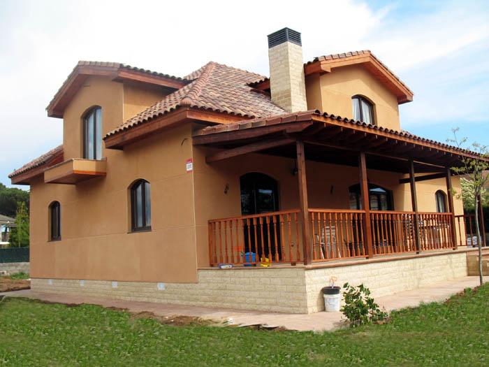 Casa de madera casas prefabricadas foto casa de madera acabado exterior con imitacion de piedra - Casas prefabricadas madera y piedra ...